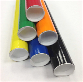 Group of mailing tubes of different colors with white plugs