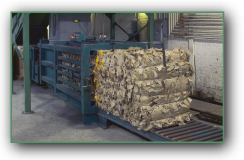 Bailer machine bundling cardboard for recycling